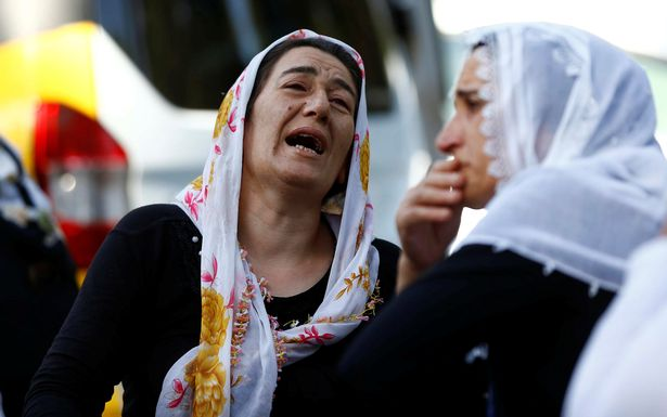 Women mourn as they wait in front of a hospital morgue in the Turkish city of Gaziantep