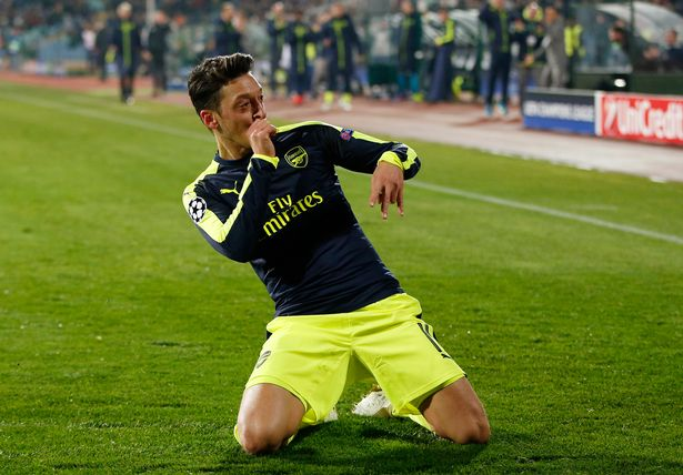 Mesut Ozil celebrates scoring their third goal