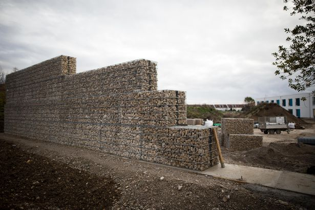 Wall being built next to a refugee camp in Neuperlach Sud, Germany