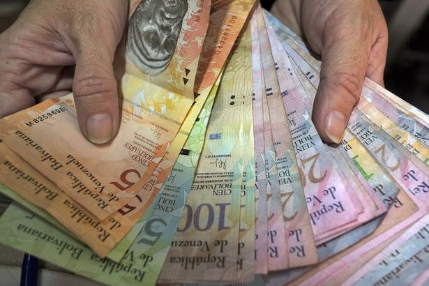 Image result for Venezuela's currency now worth so little shopkeepers weigh vast piles of notes instead of counting them