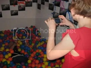 picture of linda lay taking a picture of charlene in the ball pit