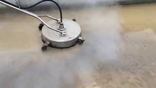 Concrete cleaning, hot water and a whole lot of pressure
