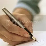 writing pen photo: Hand holding Pen Writing.jpg