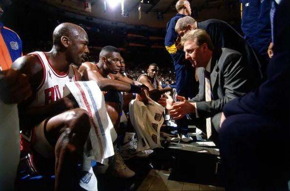Michael Jordan and Larry Bird (1998 All-Star Game) BG : Dikembe Mutombo
