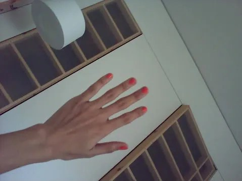 Orange nails by Tallulah Morton
