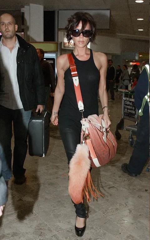 Victoria Beckham pics with Louis Vuitton messenger bag spring summer 2010
