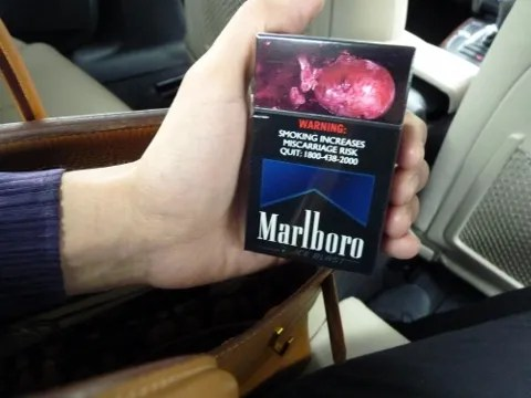 photo of a dead fetus, marlboro pack