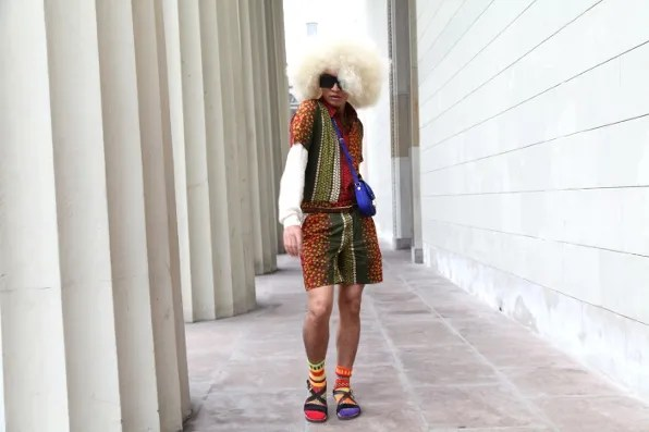Oversized blond afro wig worn by Bryanboy in Copenhagen, Denmark