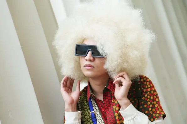 Bryanboy wearing a blond afro wig
