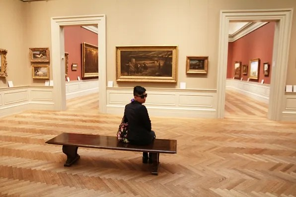 Bryanboy sitting at a gallery inside the Metropolitan Museum of Art