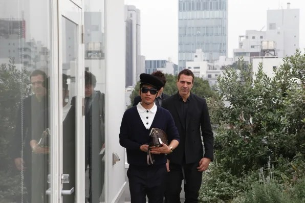 Bryanboy and Ennio Capasa walking on the balcony