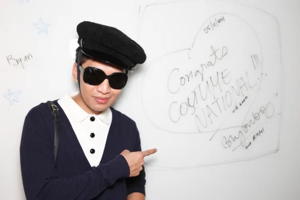 Bryanboy pointing to his autograph for Costume National