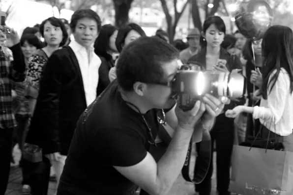 Japanese photographer taking a shot of Bryanboy