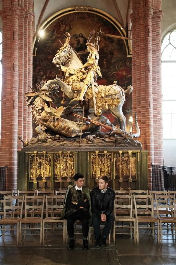 Fabian and Bryan sitting in front of St. George and the Dragon inside Storkyrkan