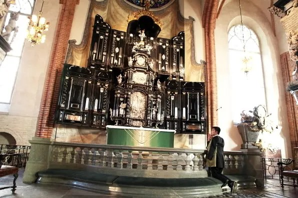 Bryanboy on his knees inside Storkyrkan