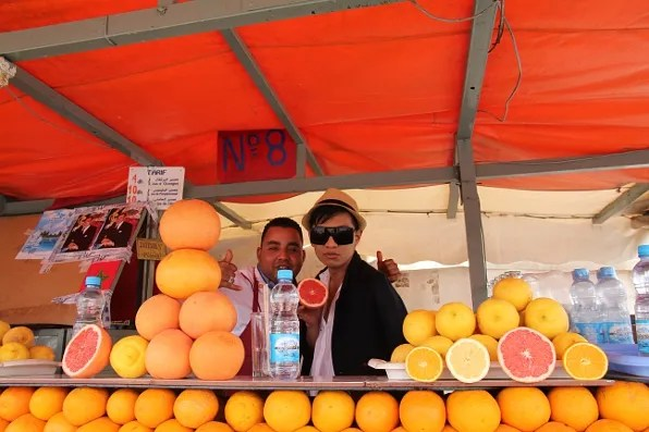 Bryanboy with grapefruit and orange juice stand at Jemaa el-fna, Marrakesh