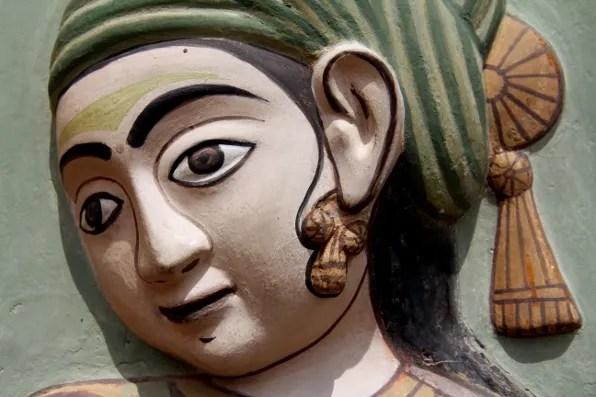 Wall sculpture of a woman at City Palace Jaipur