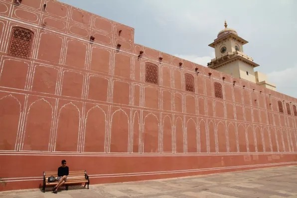 Bryanboy sitting on a bench at City Palace, Jaipur