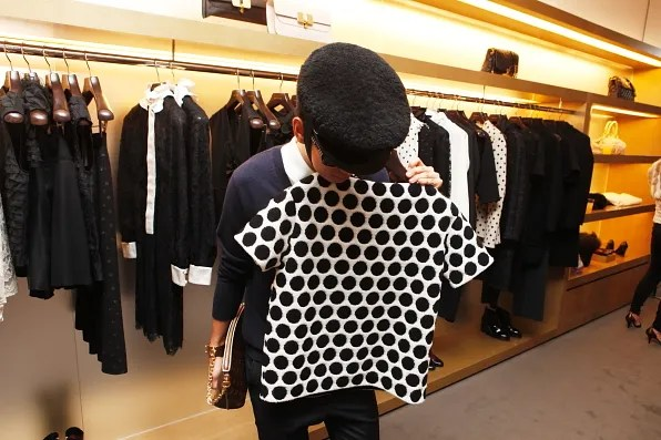 Bryanboy holding a polka dot Marc Jacobs top