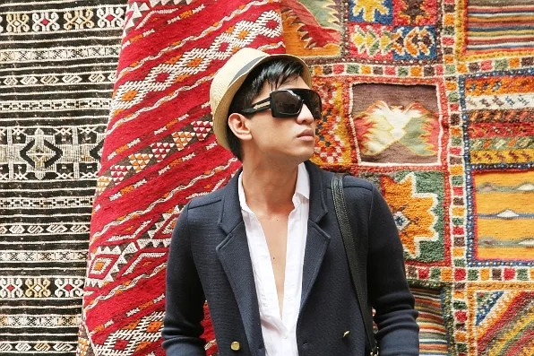 Bryanboy outside a store selling Moroccan carpets