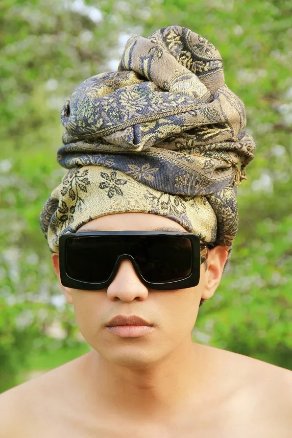 Bryanboy wearing a shawl as a turban.