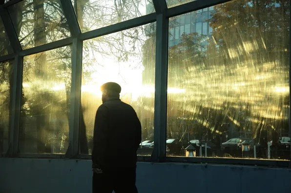 Man walking in the city at sunset, Moscow