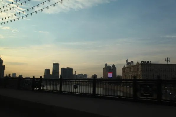 Watching the sunset from a bridge, Moscow