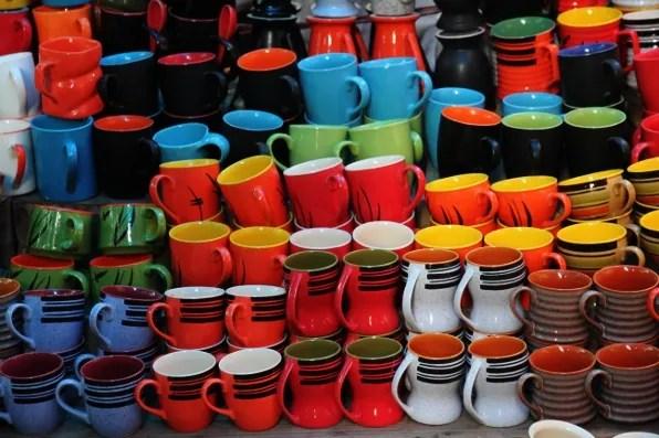 Colourful mugs at Dilli Haat market New Delhi
