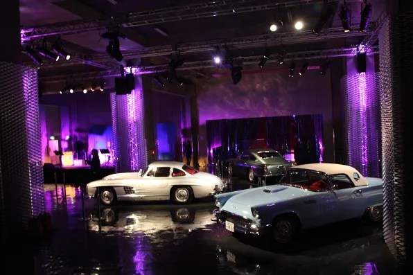 Vintage Cadillac cars at the Prada spring summer 2012 fashion show