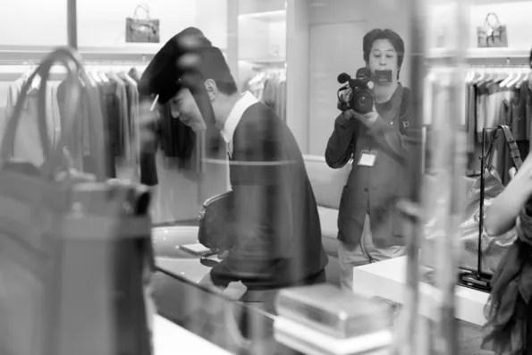 Bryanboy being filmed inside the Reed Krakoff store