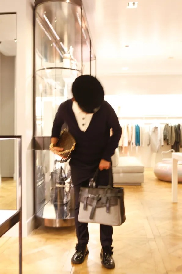 Bryanboy trying on a Reed Krakoff Boxer tote bag