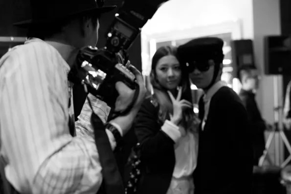 Bryanboy posing with a Japanese fan at the Roberto Cavalli store, Tokyo