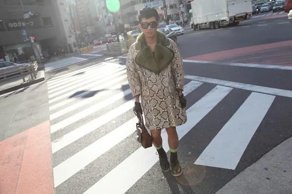 Bryanboy wearinga python coat from Prada in Shinjuku, Tokyo
