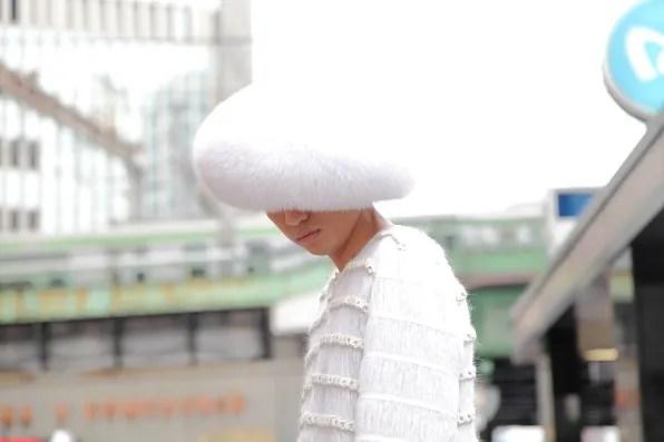 Bryanboy wearing an Adrienne Landau fox fur hat in Tokyo