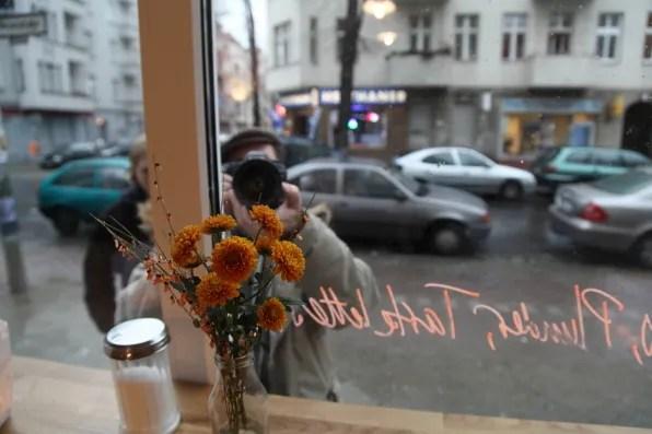 Bryanboy being filmed inside a cafe in Berlin