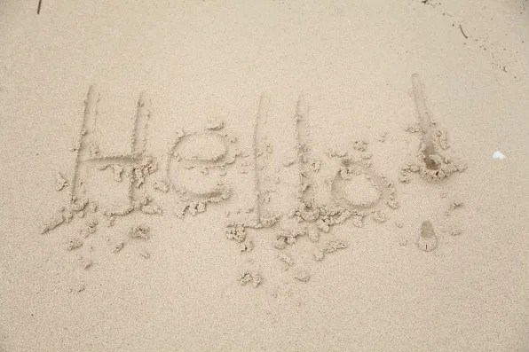 Hello sign on the beach