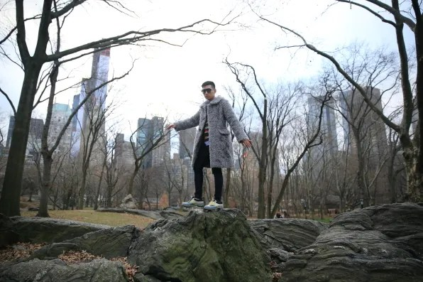 Bryanboy wearing a gray Marc Jacobs coat in Central Park, New York