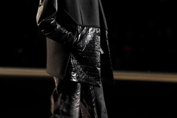 Detail shot of sleeveless coat from Edun fall winter 2012