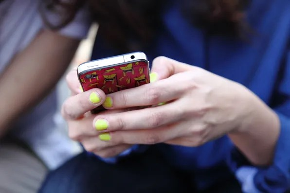 Eleonora Carisi's Lady Gaga iphone case and neon yellow nails