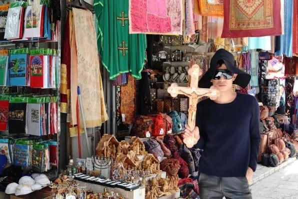 Bryanboy holding a crucifix in Jerusalem