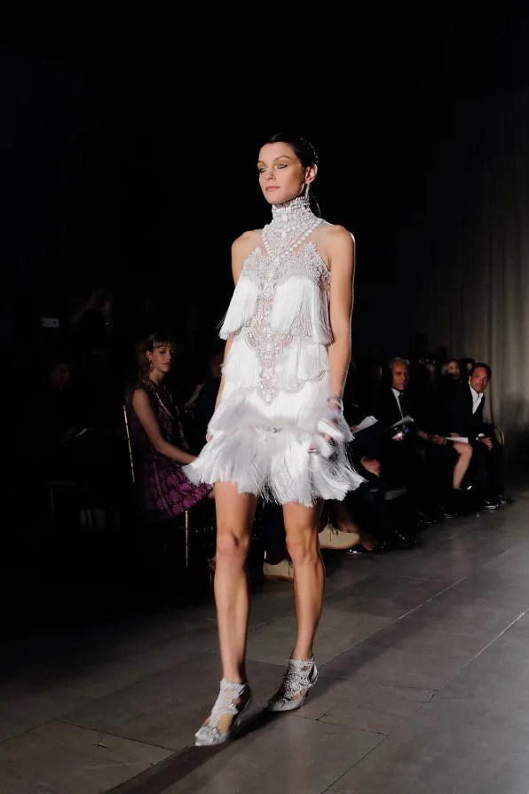 Jessica Stam wearing a white fringe dress at Marchesa spring summer 2013 fashion show