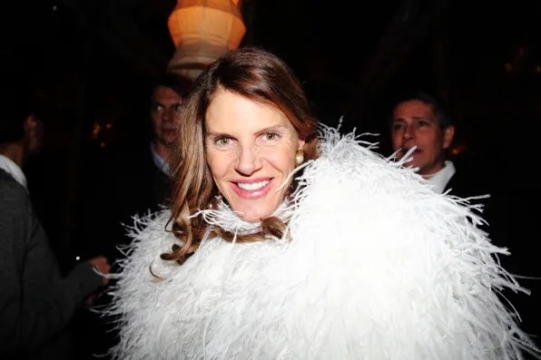 Anna Dello Russo in Yves Saint Laurent white feather dress