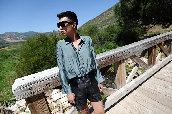 Bryanboy wearing a metallic green Michael Angel shirt