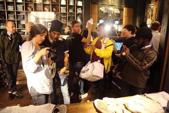 Bryanboy being photographed at Replay store