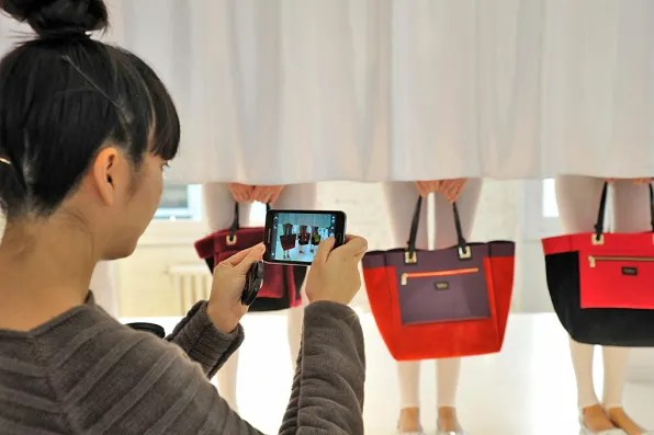 Blogger Susie Bubble photographing Furla performance installation