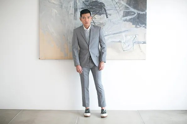 Bryanboy wears a suit from Calvin Klein collection