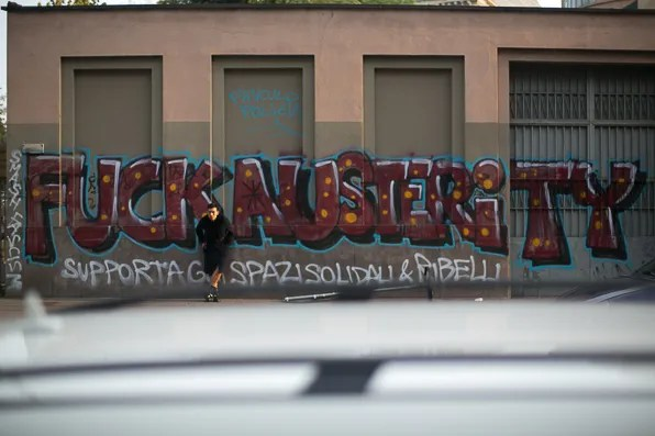 Fuck Austerity graffiti at Via Santa Sofia, Milano