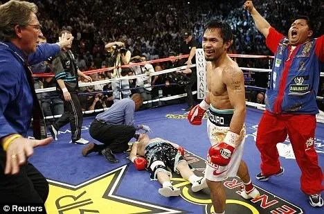Hatton vs Pacquiao fight photos. TKO Knock out 2nd round