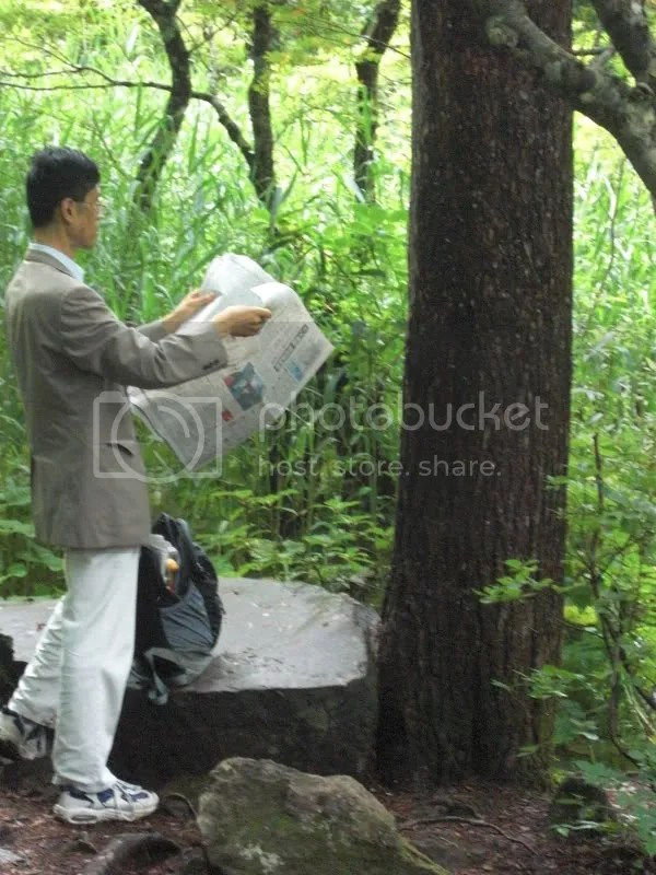 Even salary man visits the ponds...erm...to read business news..