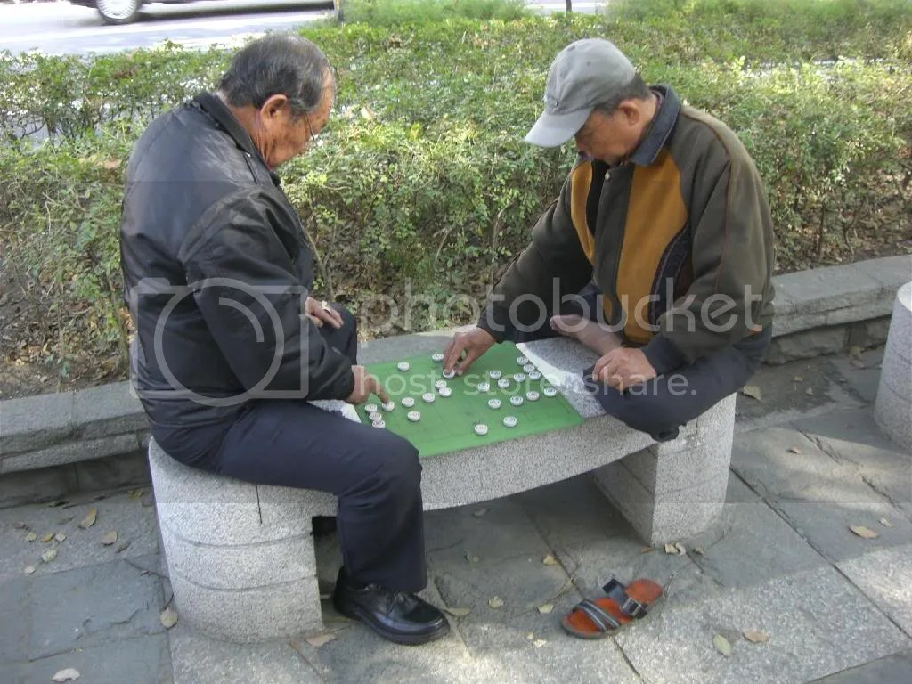 Elders still play Chinese chess to pass time.